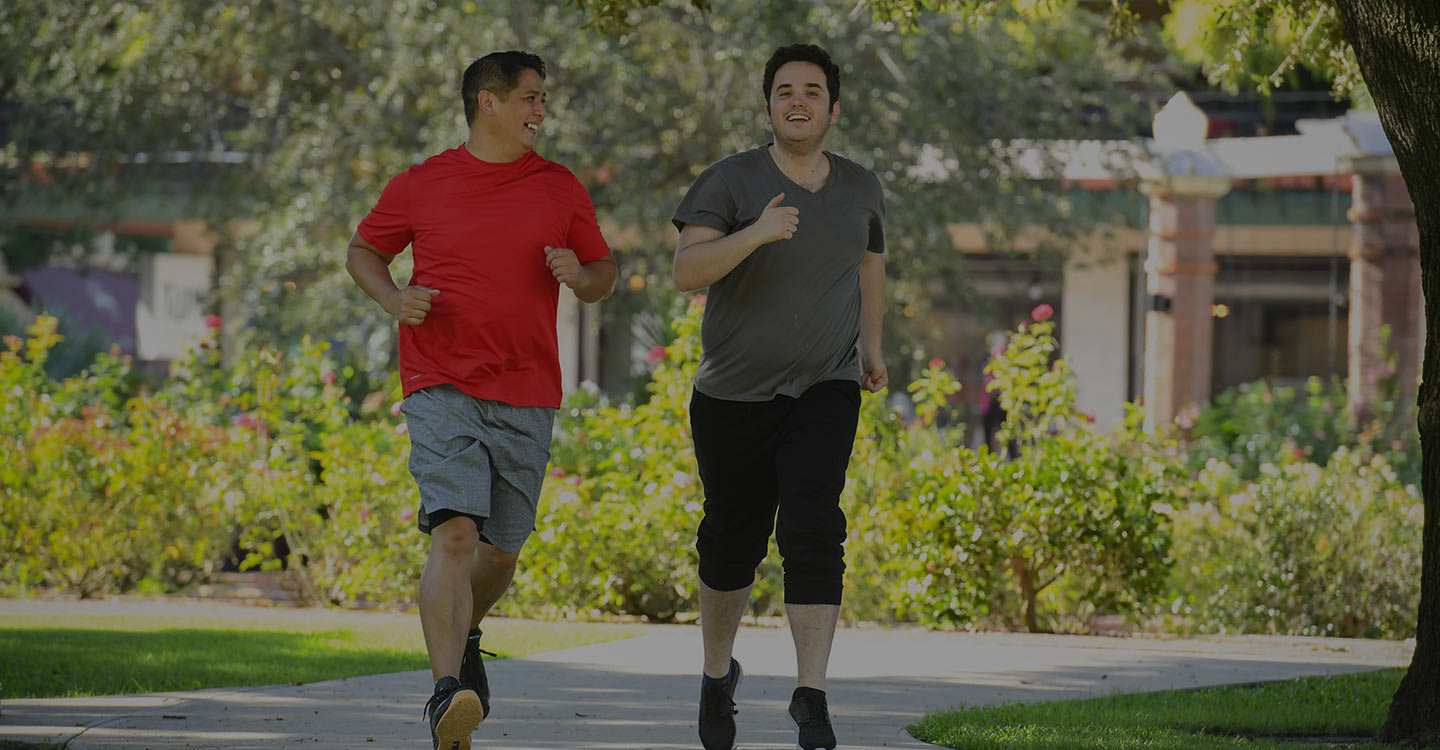 Two men jogging outside to promote a healthy lifestyle