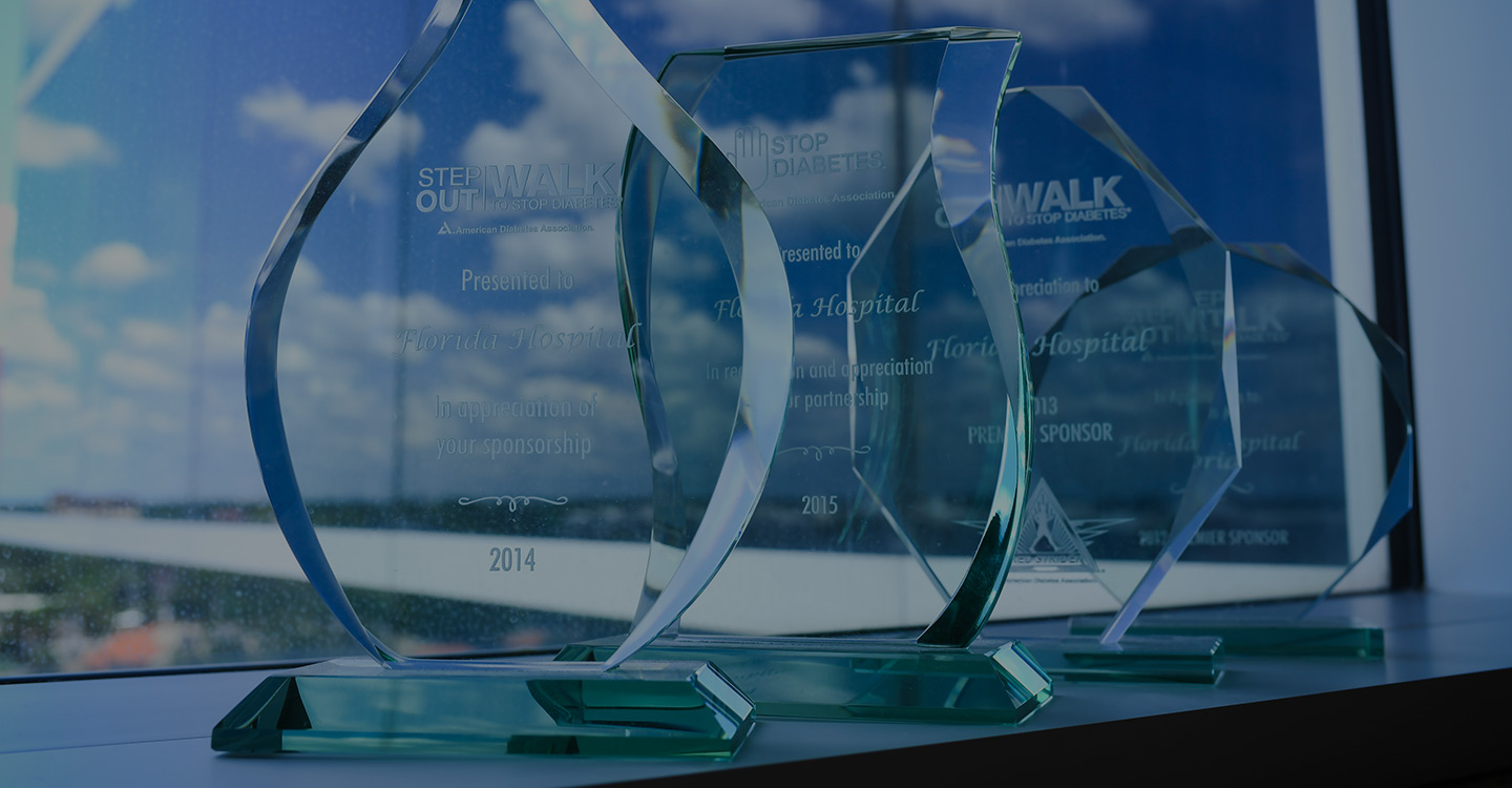 Four glass trophies awarding the AdventHealth Diabetes Institute for their outstanding work