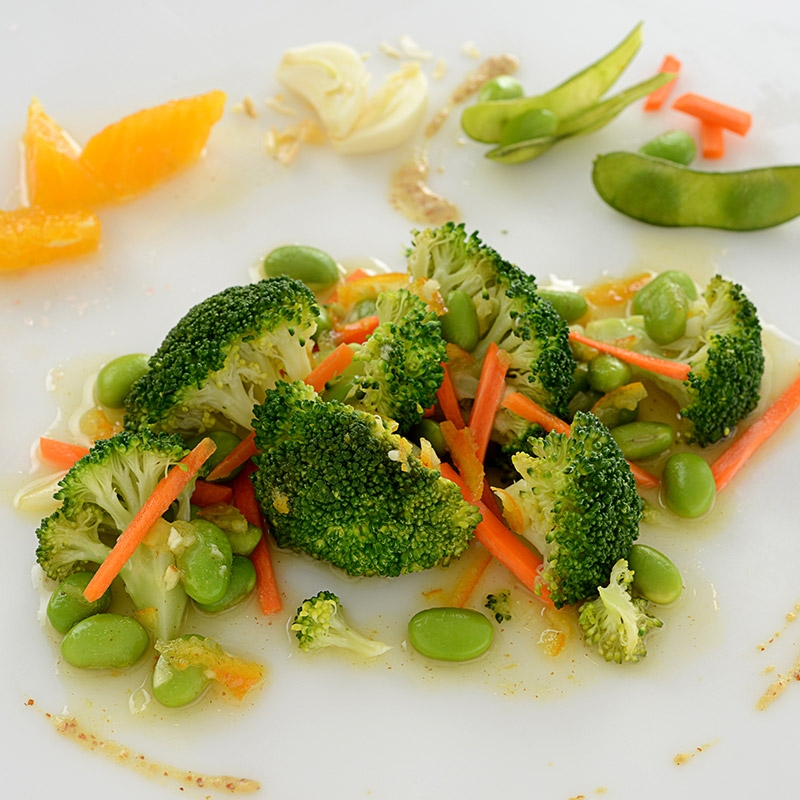 A healthy side dish of broccoli, edamame, and carrots