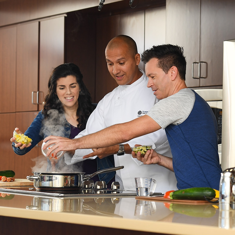 Local chef teaches couple how to take charge of their diabetes in a kitchen