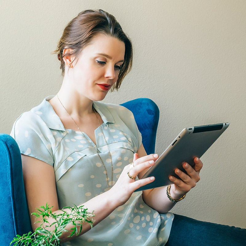 Woman on an iPad requests an appointment to speak with a PCOS specialist at Florida Hospital Diabetes Institute